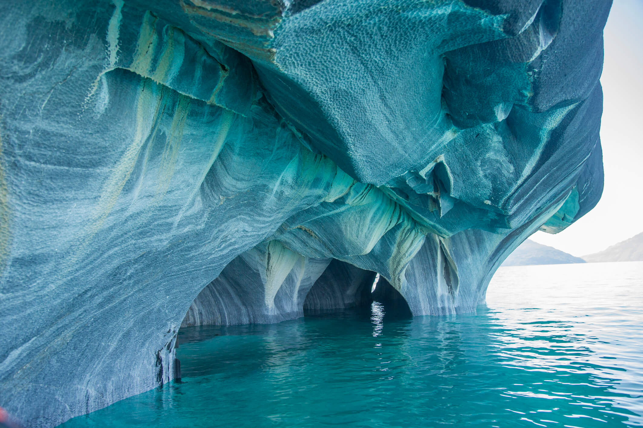 Seaside caves of marble carved out by lapping water.