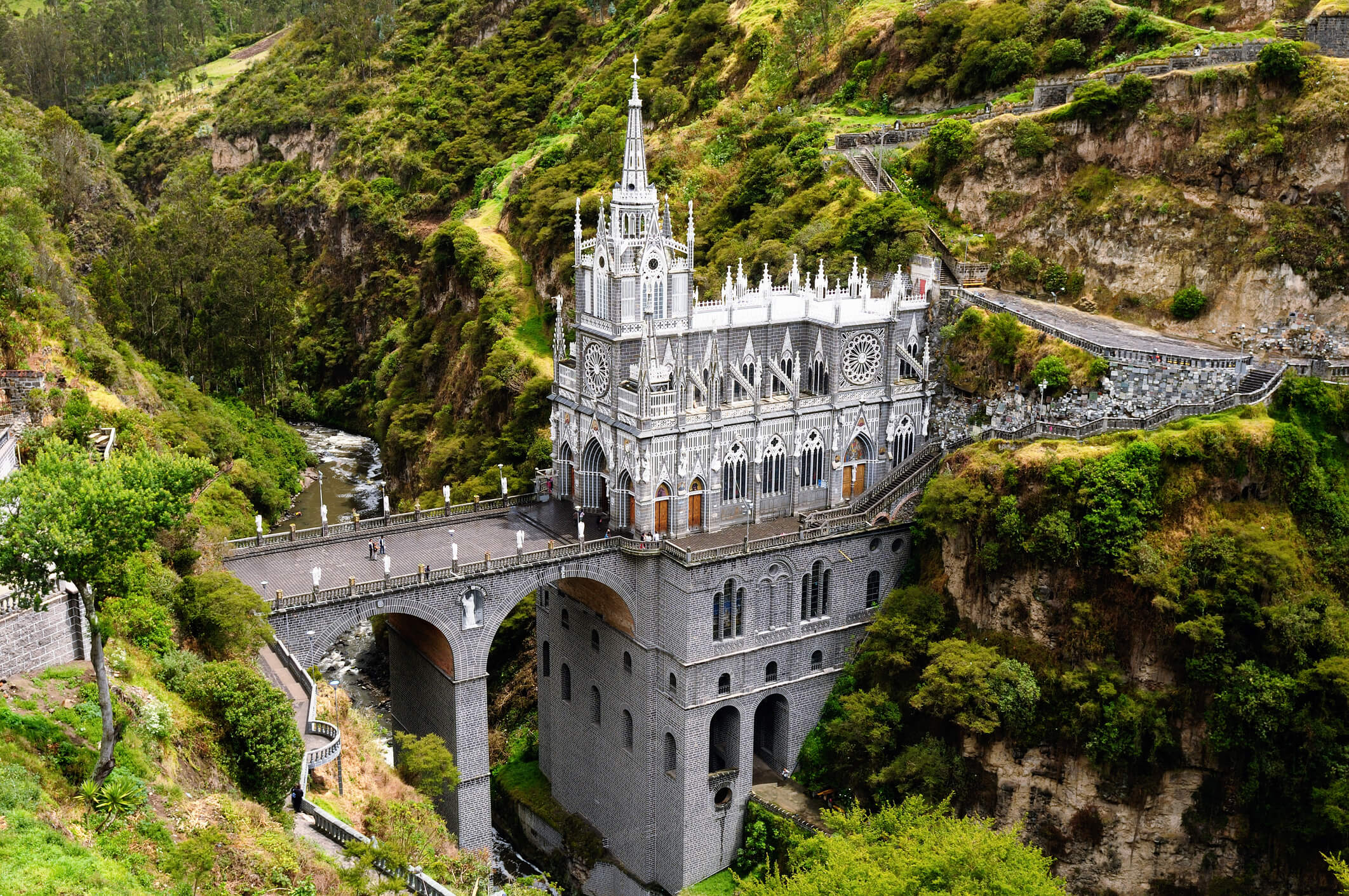 Gothic revival cathedral built into a cliffside.