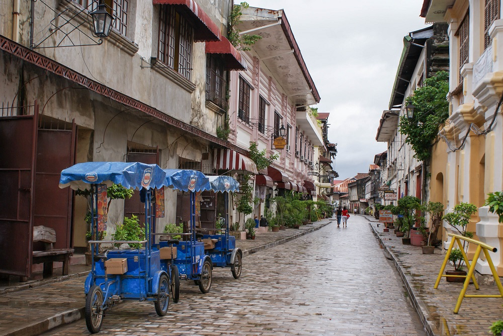 Cobblestone streets of Vigan City with tricycles