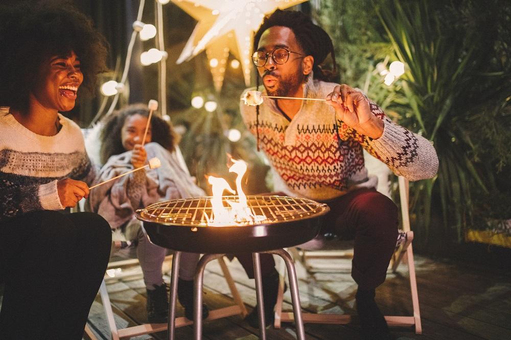 People roasting marshmallows around the campfire
