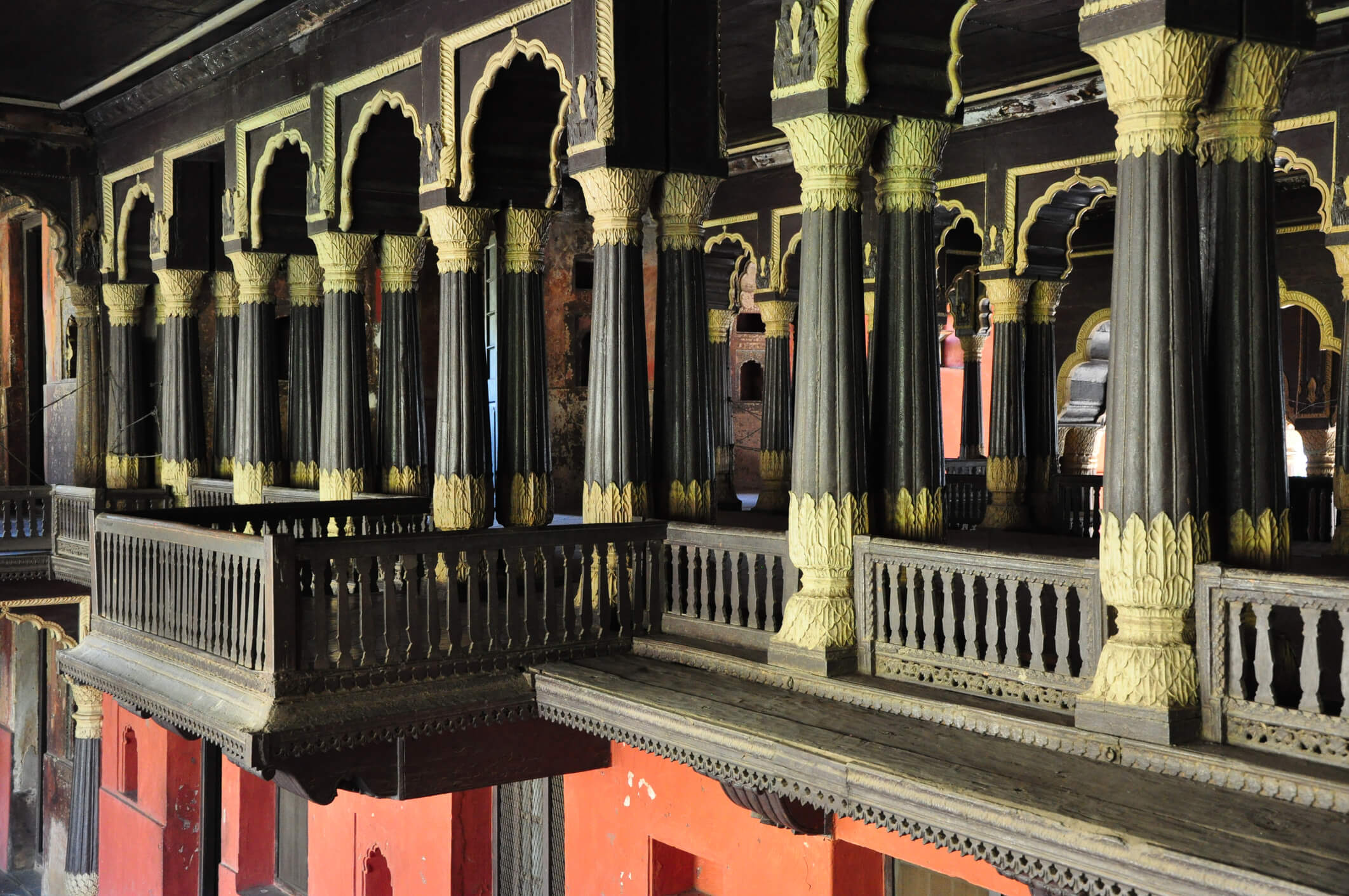 Palace arches and pillars carved from teakwood