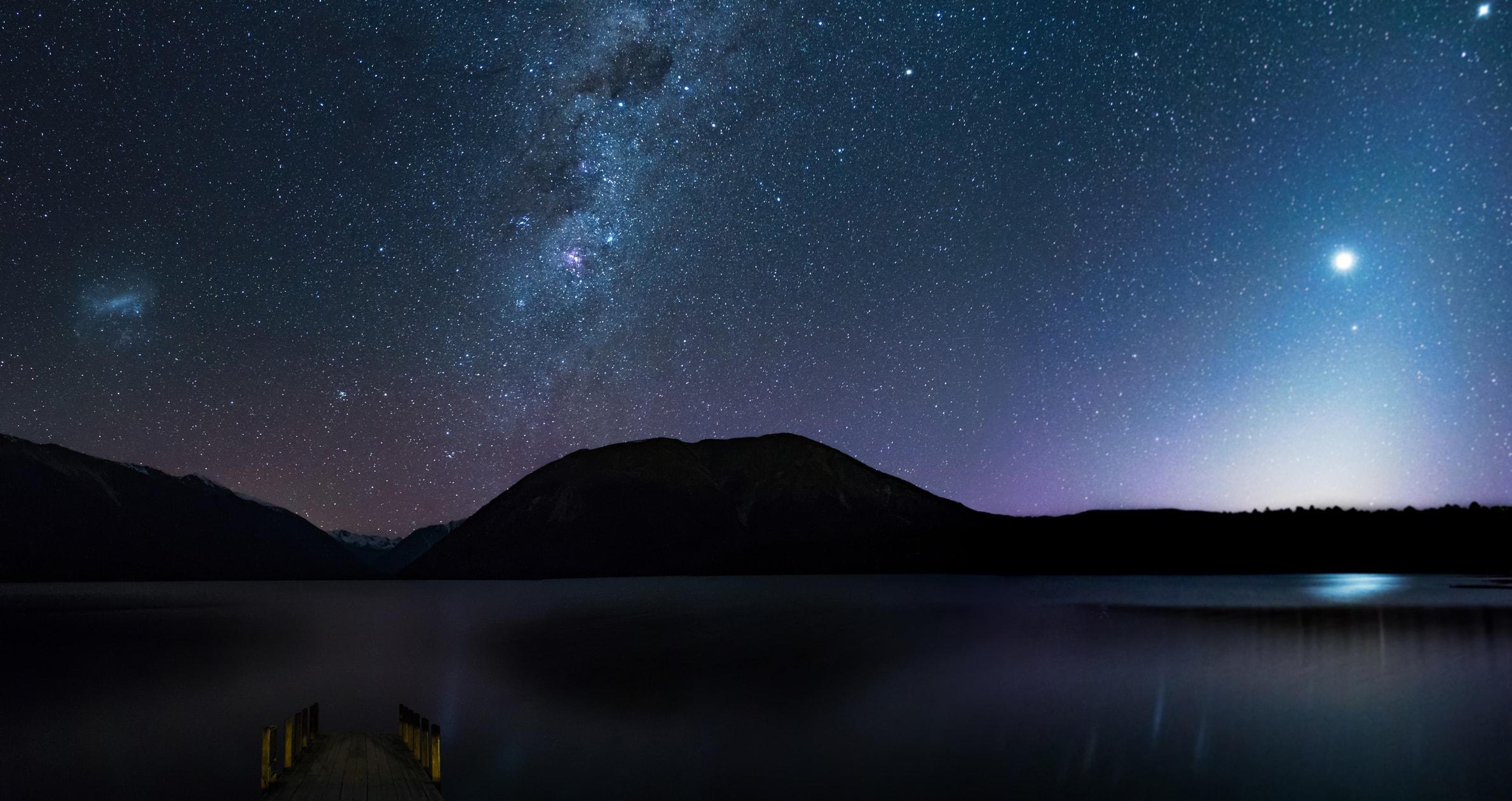 The waters of Lake Rotoiti reflect the night sky