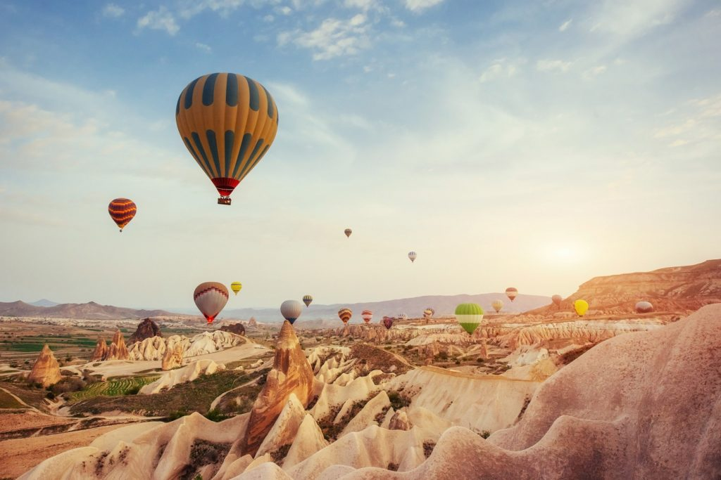 balloons floating over goreme